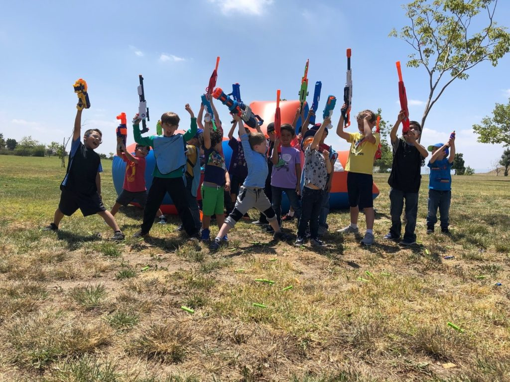 Group of kids participating in a Nerf Gun Party in Cypress, Orange County California. They chose to use Mega Nerf Guns to color coordinate with the nerf arena that we provided for the birthday boy.