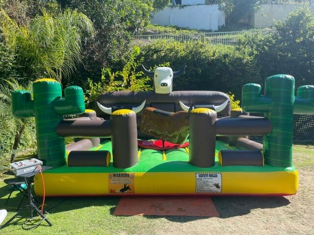 The Mechanical Bull with a brown bull and inflatable bed with a white bull head
